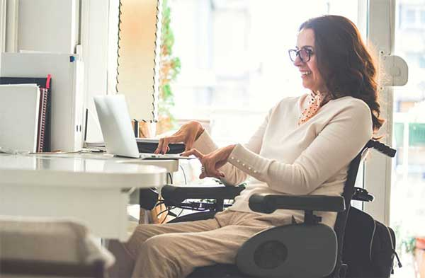 Woman in wheelchair working on computer