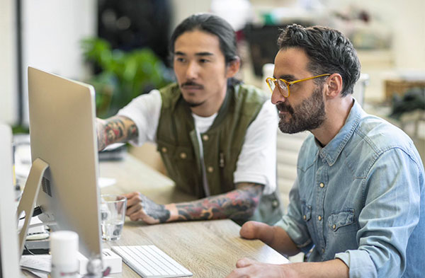 two men at a computer